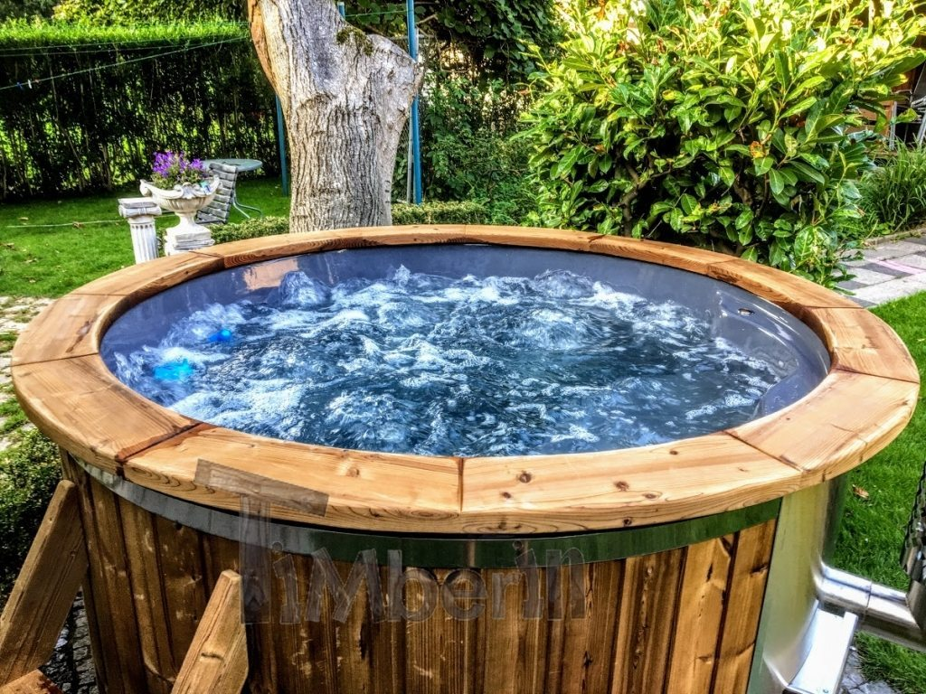 Wooden hot tub with the round edge