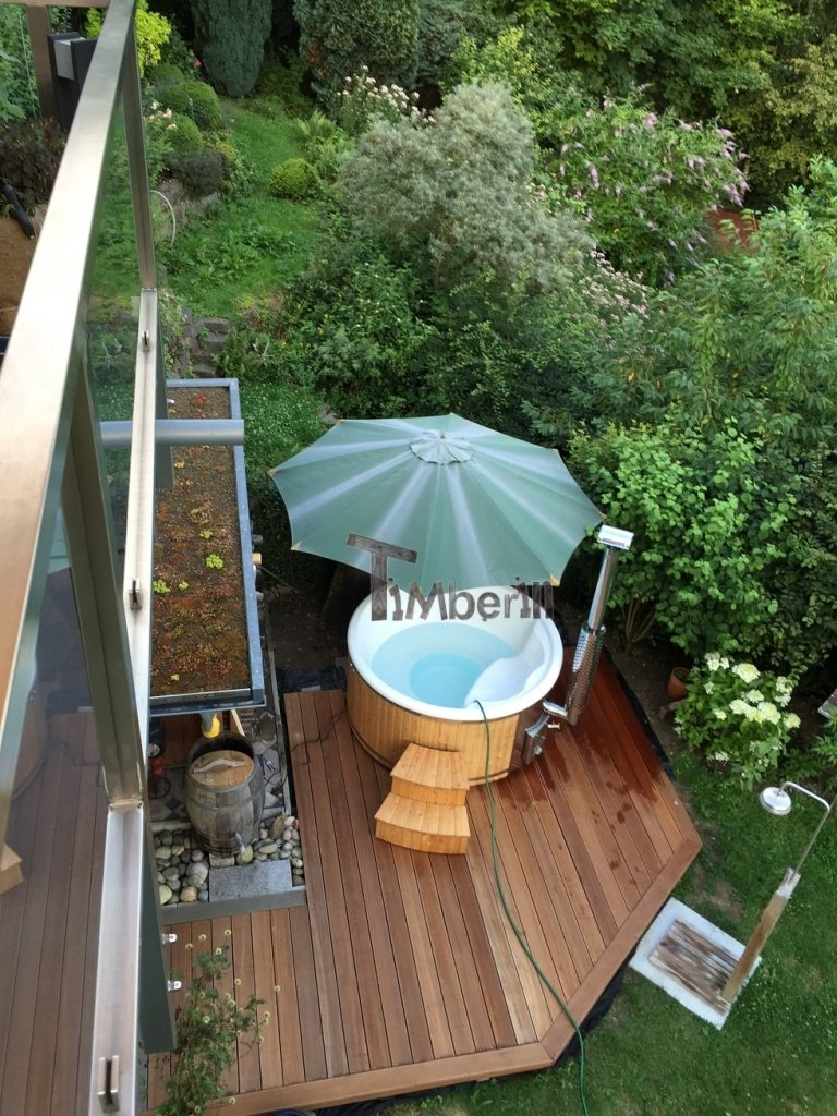 Wellness Royal ahot tub on a terrace with integrated oven